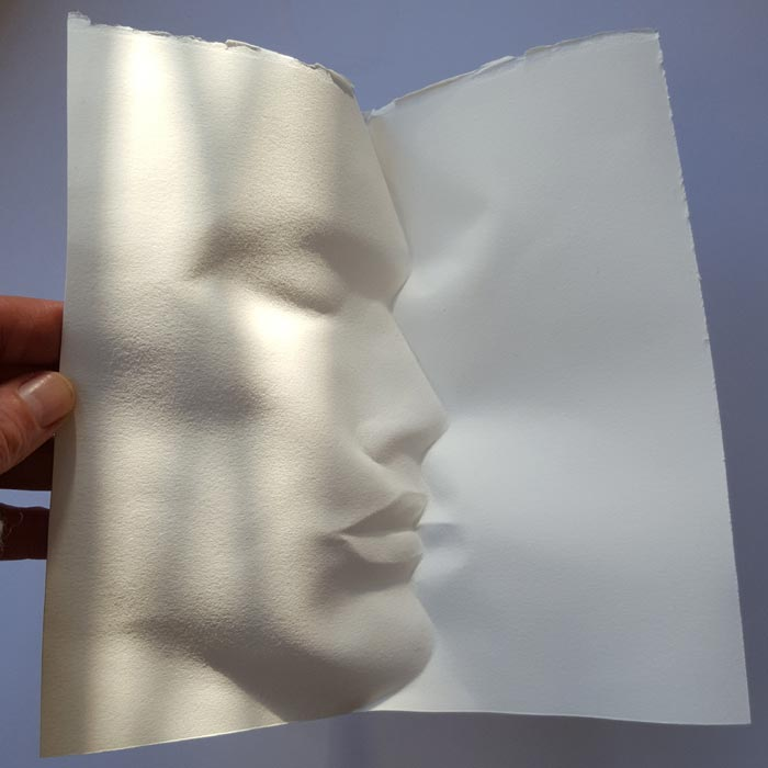 Paper into seemingly impossible forms of the face