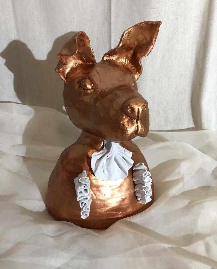 The dog sculpture is called : Boston Terrier Tea Party