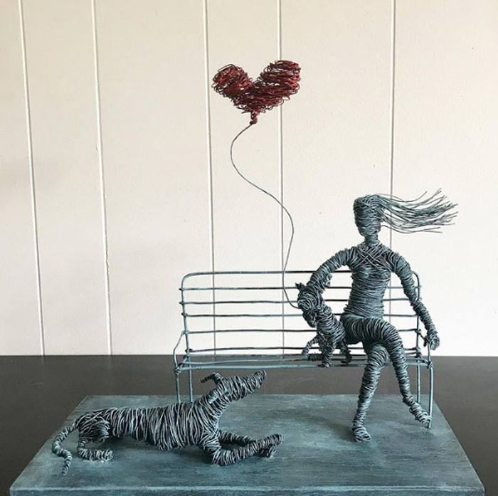 lovely lady and family sculpture by Annie Glass