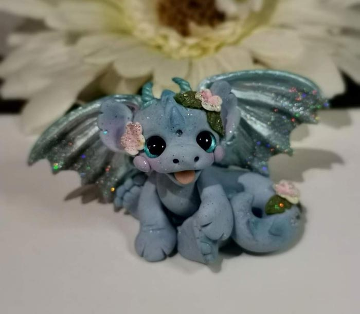 Polymer clay dragon with wings by Laura