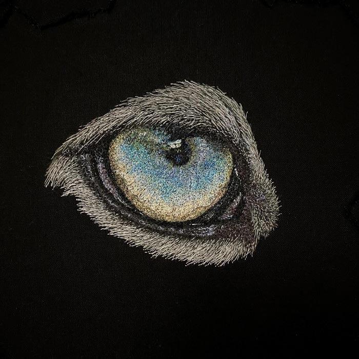 Snowleopard eye textile art