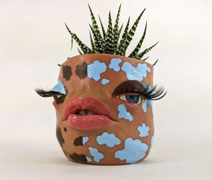 Cute face pots by Tender Flesh
