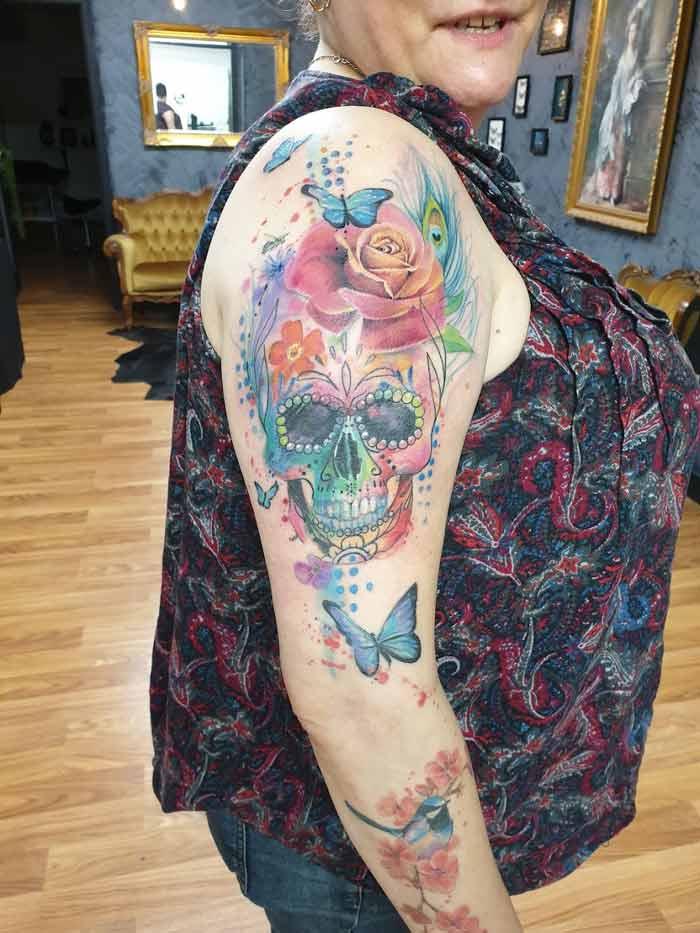 Skull tattoo art by Jess Hannigan