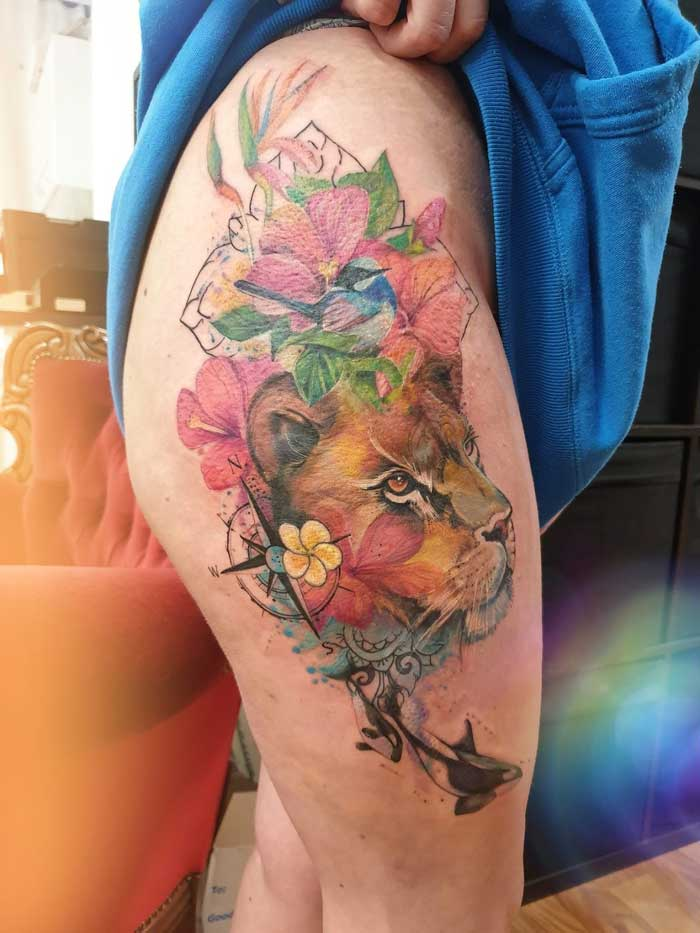 Amazing tattoo art on thigh by Jess Hannigan